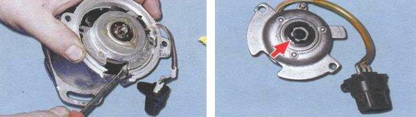 При помощи отвертки выдергиваем опорную пластинку, проверяем состояние ее втулки